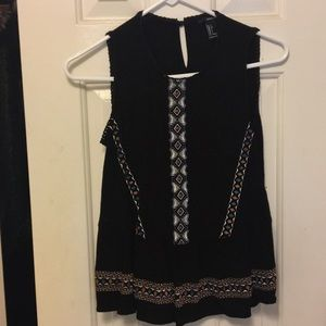 Black tank top with embroidery.